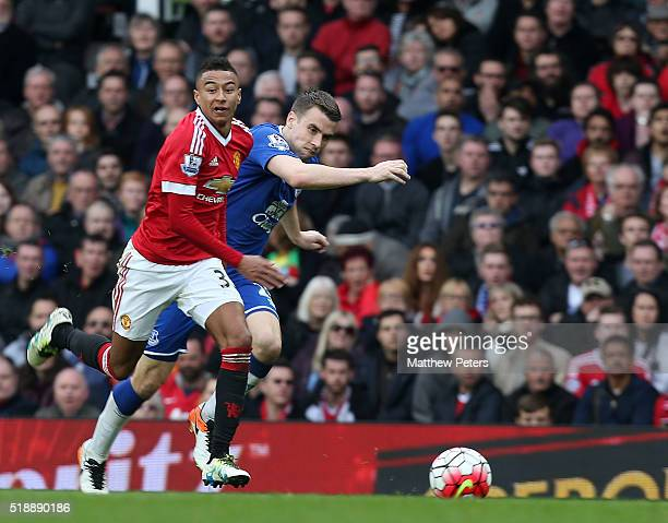 Jesse Lingard of Manchester United in action with Seamus Coleman of Everton during the Barclays Premier League match between Manchester United and...