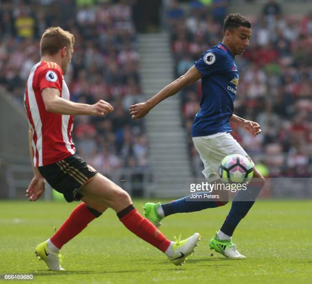 Jesse Lingard of Manchester United in action with Sebastian Larsson of Sunderland during the Premier League match between Sunderland and Manchester...