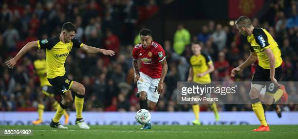 Jesse Lingard of Manchester United in action with Tom Flanagan of Burton Albion during the Carabao Cup Third Round between Manchester United and...