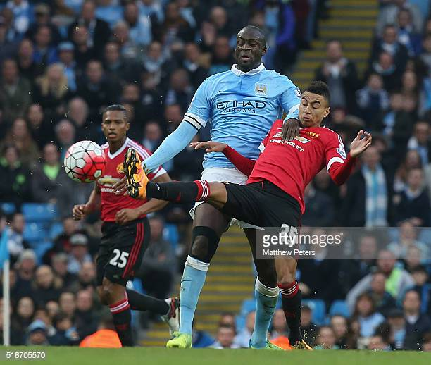 Jesse Lingard of Manchester United in action with Yaya Toure of Manchester City during the Barclays Premier League match between Manchester City and...