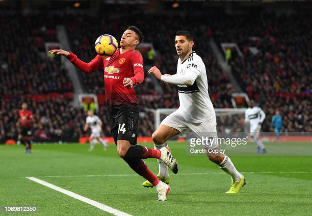 Jesse Lingard of Manchester United is challenged by Aleksandar Mitrovic of Fulham during the Premier League match between Manchester United and...