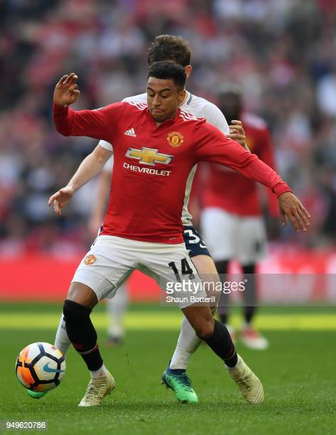 Jesse Lingard of Manchester United is challenged by Ben Davies of Tottenham Hotspur during The Emirates FA Cup Semi Final match between Manchester...