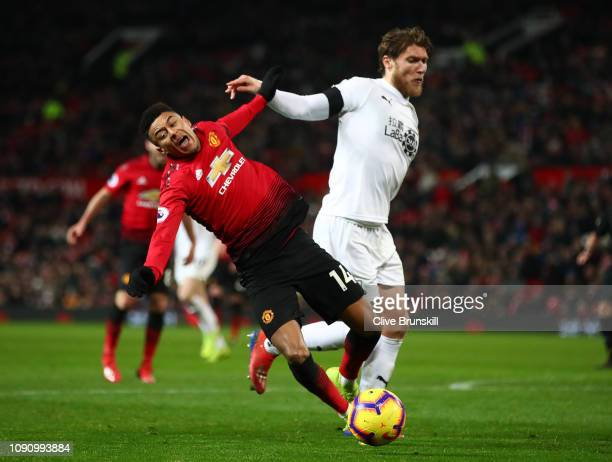 Jesse Lingard of Manchester United is challenged by Jeff Hendrick of Burnley during the Premier League match between Manchester United and Burnley at...