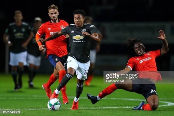 Jesse Lingard of Manchester United is challenged by Peter Kioso of Luton Town during the Carabao Cup Third Round match between Luton Town and...