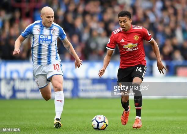 Jesse Lingard of Manchester United is chased Aaron Mooy of Huddersfield Town during the Premier League match between Huddersfield Town and Manchester...
