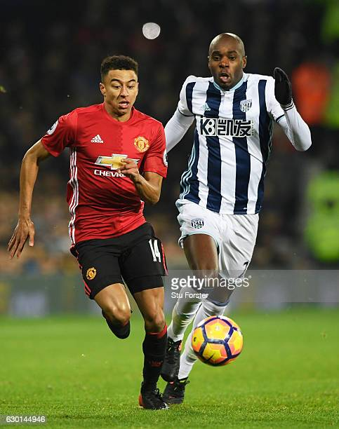 Jesse Lingard of Manchester United is chased dowb by Allan Nyom of West Bromwich Albion during the Premier League match between West Bromwich Albion...