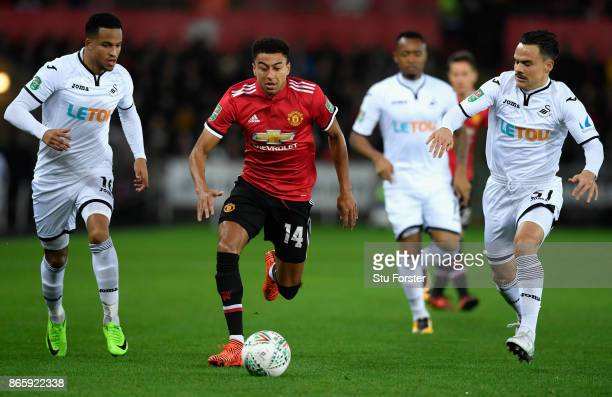 Jesse Lingard of Manchester United is closed down by Martin Olsson of Swansea City and Roque Mesa of Swansea City during the Carabao Cup Fourth Round...