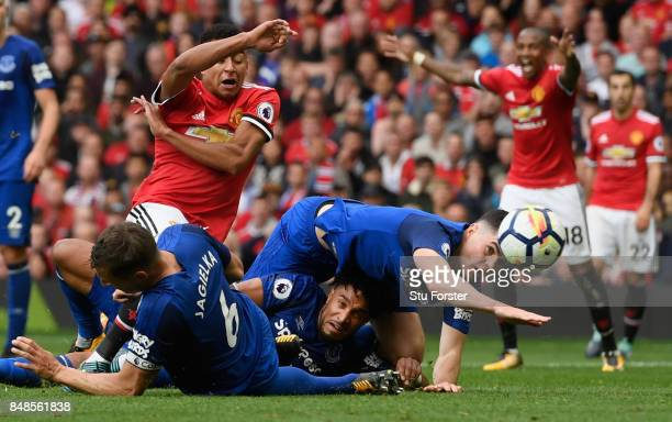 Jesse Lingard of Manchester United is denied by Everton defenders Phil Jagielka Ashley Williams and Michael Keane during the Premier League match...