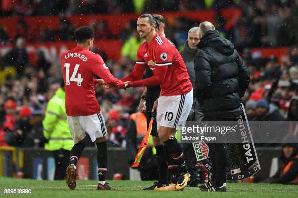 Jesse Lingard of Manchester United is subbed for Zlatan Ibrahimovic of Manchester United during the Premier League match between Manchester United...