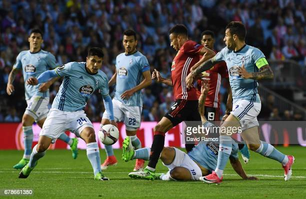 Jesse Lingard of Manchester United is watched by the Celta Vigo defence during the UEFA Europa League semi final first leg match between Celta Vigo...