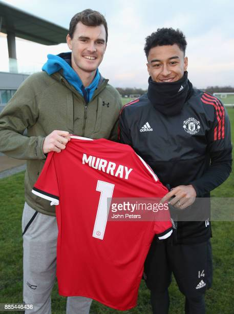 Jesse Lingard of Manchester United poses with tennis player Jamie Murray ahead of a first team training session at Aon Training Complex on December 4...