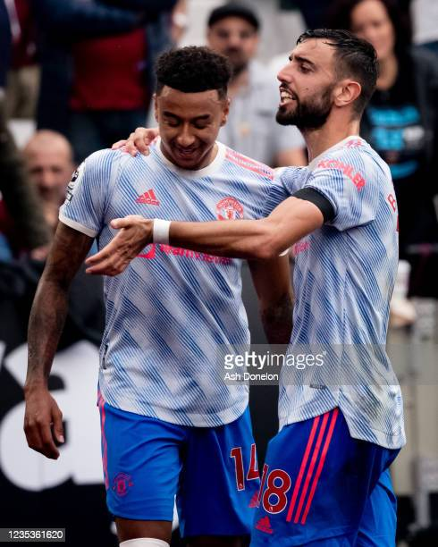 Jesse Lingard of Manchester United reacts to his goal with Bruno Fernandes during the Premier League match between West Ham United and Manchester...