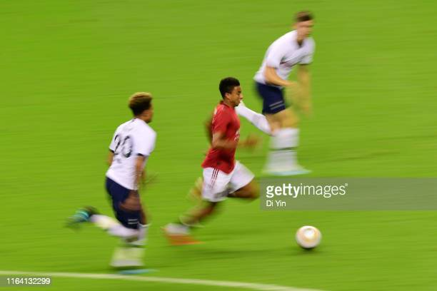 Jesse Lingard of Manchester United runs with the ball during the International Champions Cup match between Tottenham Hotspur and Manchester United at...