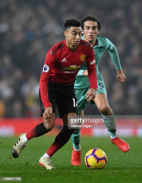 Jesse Lingard of Manchester United runs with the ball under pressure from Matteo Guendouzi of Arsenal during the Premier League match between...