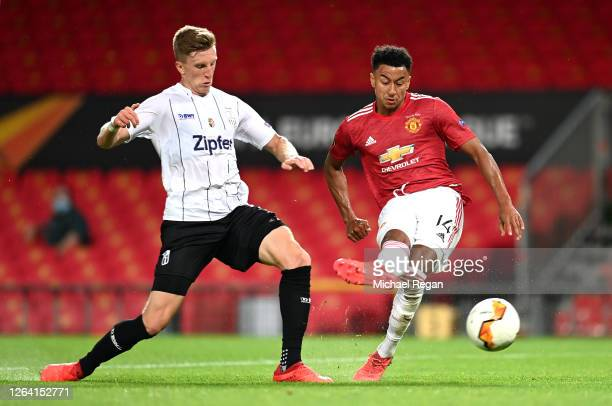 Jesse Lingard of Manchester United scores his sides first goal during the UEFA Europa League round of 16 second leg match between Manchester United...