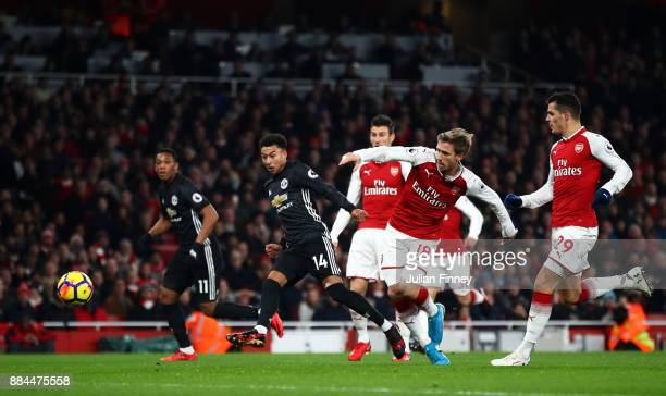 Jesse Lingard of Manchester United scores his sides second goal as Nacho Monreal of Arsenal attempts to tackle him during the Premier League match...