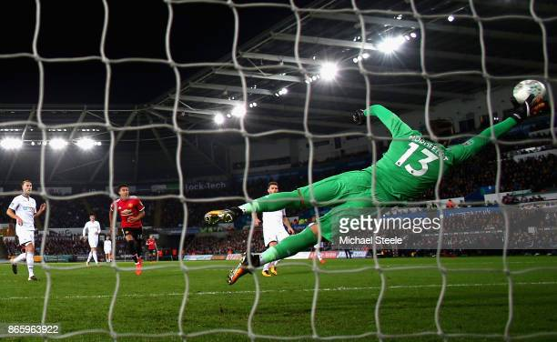 Jesse Lingard of Manchester United scores his sides second goal past Kristoffer Nordfeldt of Swansea City during the Carabao Cup Fourth Round match...