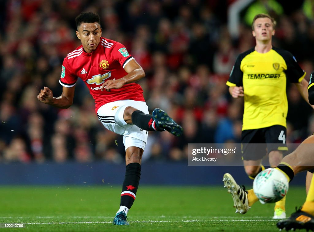 Jesse Lingard of Manchester United scores his sides third goal during the Carabao Cup Third Round match between Manchester United and Burton Albion at Old Trafford on September 20, 2017 in Manchester, England.