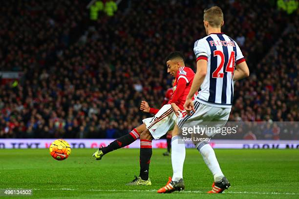 Jesse Lingard of Manchester United scores his team's first goal during the Barclays Premier League match between Manchester United and West Bromwich...