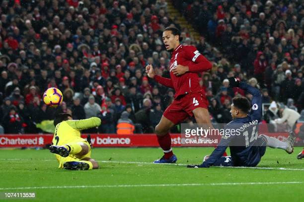 Jesse Lingard of Manchester United scores his team's first goal past Alisson of Liverpool and Virgil van Dijk of Liverpool during the Premier League...