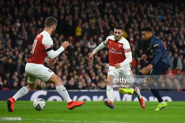 Jesse Lingard of Manchester United scores scores his team's second goal as Sead Kolasinac and Shkodran Mustafi of Arsenal look on during the FA Cup...