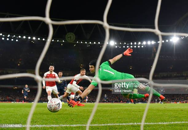 Jesse Lingard of Manchester United scores scores his team's second goal past Petr Cech of Arsenal during the FA Cup Fourth Round match between...