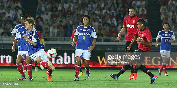 Jesse Lingard of Manchester United scores their first goal during the preseason friendly match between Yokohama FMarinos and Manchester United at...