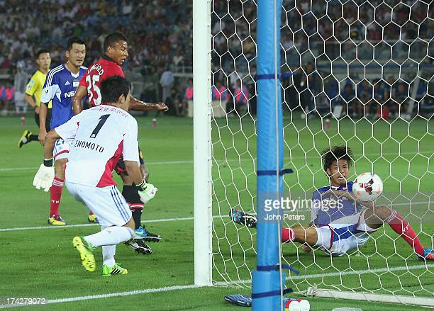 Jesse Lingard of Manchester United scores their first goal during the pre-season friendly match between Yokohama F.Marinos and Manchester United at...