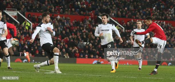 Jesse Lingard of Manchester United scores their first goal during the Emirates FA Cup Third Round match between Manchester United and Derby County at...