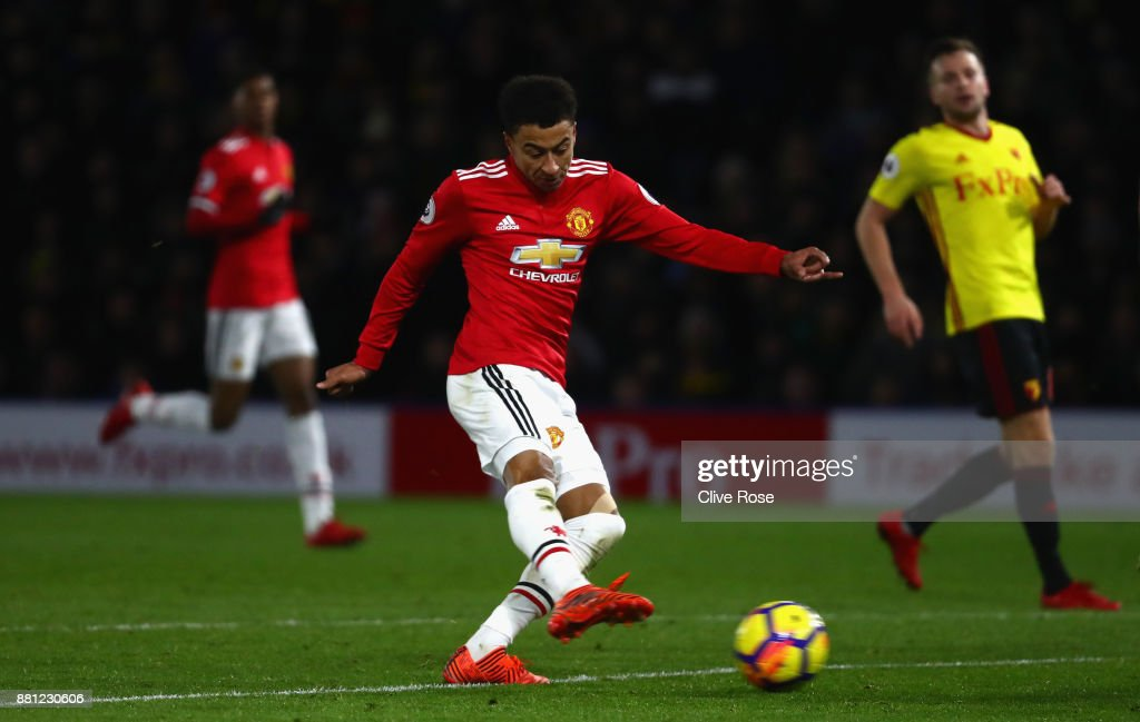Jesse Lingard of Manchester United scores their fourth goal during the Premier League match between Watford and Manchester United at Vicarage Road on November 28, 2017 in Watford, England.