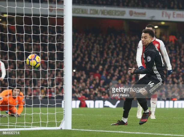 Jesse Lingard of Manchester United scores their third goal during the Premier League match between Arsenal and Manchester United at Emirates Stadium...