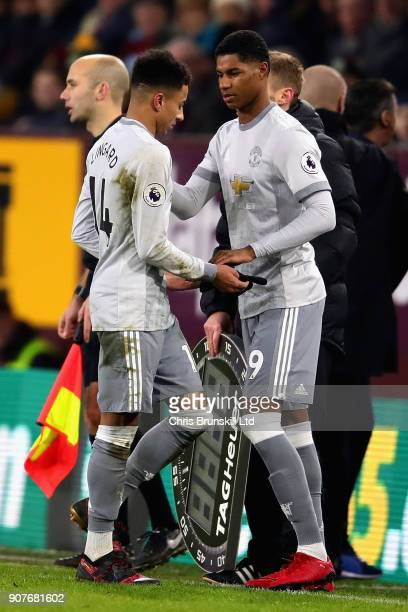 Jesse Lingard of Manchester United shakes hands with Marcus Rashford of Manchester United as he is substituted during the Premier League match...