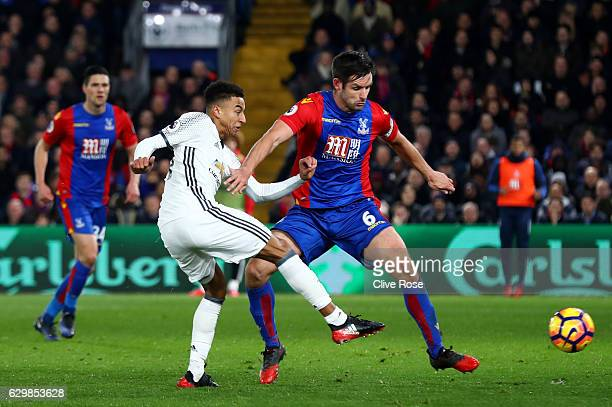 Jesse Lingard of Manchester United shoots as Scott Dann of Crystal Palace attempts to block during the Premier League match between Crystal Palace...
