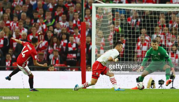 Jesse Lingard of Manchester United shoots past Maya Yoshida and Fraser Forster of Southampton to score their second goal during the EFL Cup Final...