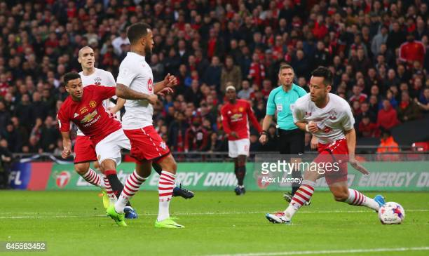 Jesse Lingard of Manchester United shoots past Maya Yoshida of Southampton to score their second goal during the EFL Cup Final match between...