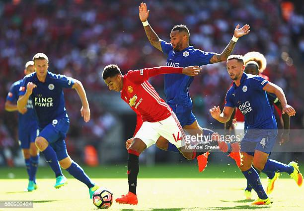Jesse Lingard of Manchester United skips past Danny Simpson of Leicester City on the way to scoring the first goal during The FA Community Shield...