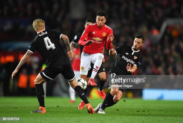 Jesse Lingard of Manchester United takes on Simon Kjaer and Pablo Sarabia of Sevilla during the UEFA Champions League Round of 16 Second Leg match...
