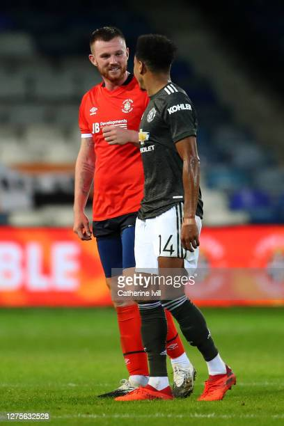 Jesse Lingard of Manchester United talks to Ryan Tunnicliffe of Luton Town during the Carabao Cup Third Round match between Luton Town and Manchester...