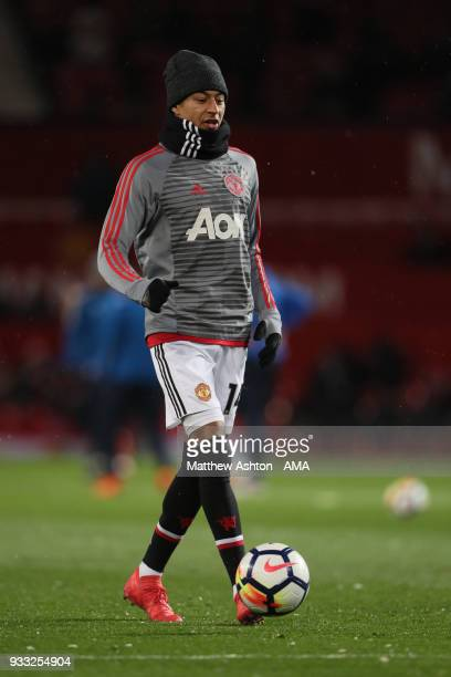 Jesse Lingard of Manchester United wears a hat and snood in the cold weather whilst warming up during the FA Cup Quarter Final match between...