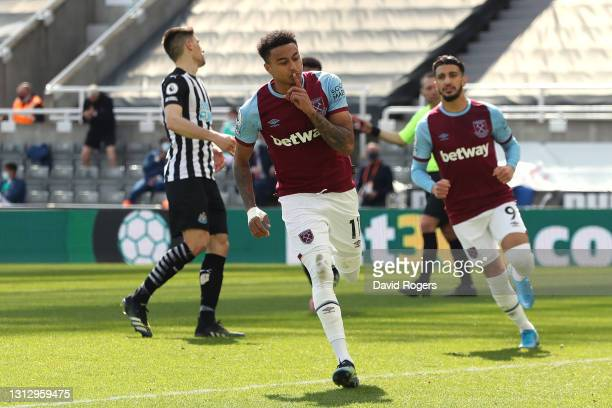 Jesse Lingard of West Ham United celebrates after scoring a penalty for his team's second goal during the Premier League match between Newcastle...