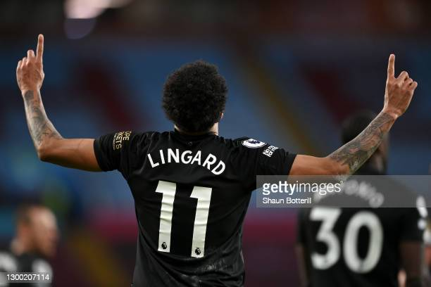 Jesse Lingard of West Ham United celebrates after scoring his team's third goal during the Premier League match between Aston Villa and West Ham...