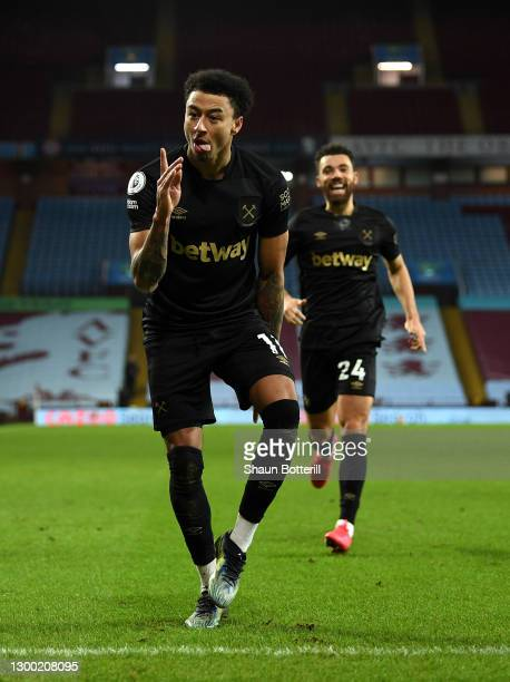 Jesse Lingard of West Ham United celebrates after scoring their side's third goal during the Premier League match between Aston Villa and West Ham...