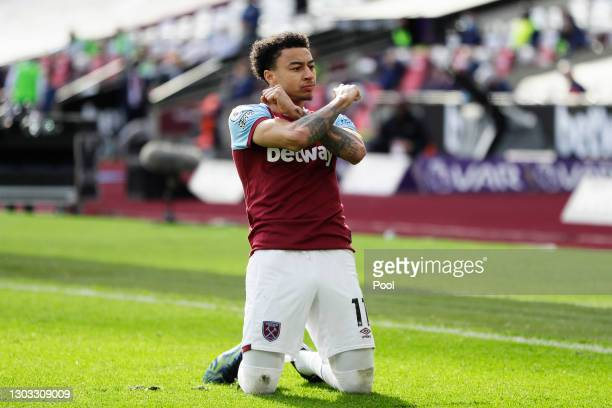 Jesse Lingard of West Ham United celebrates after scoring their side's second goal during the Premier League match between West Ham United and...