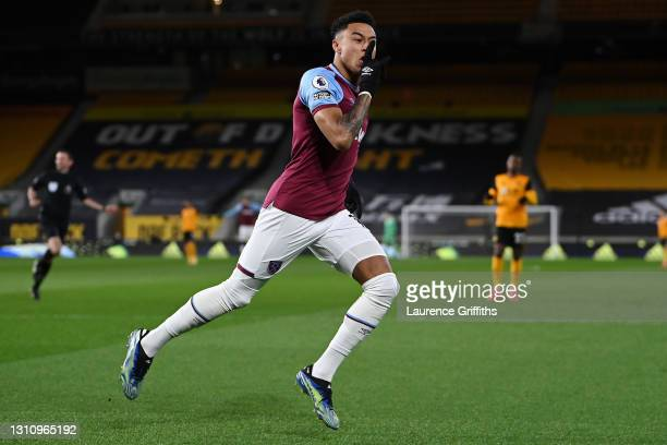 Jesse Lingard of West Ham United celebrates after scoring their team's first goal during the Premier League match between Wolverhampton Wanderers and...