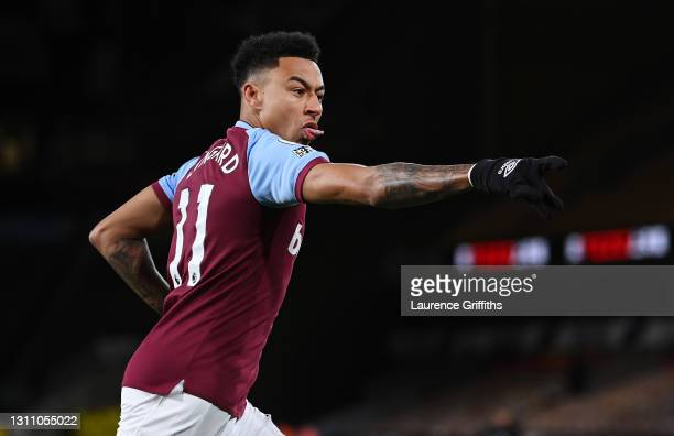 Jesse Lingard of West Ham United celebrates scoring his teams first goal during the Premier League match between Wolverhampton Wanderers and West Ham...