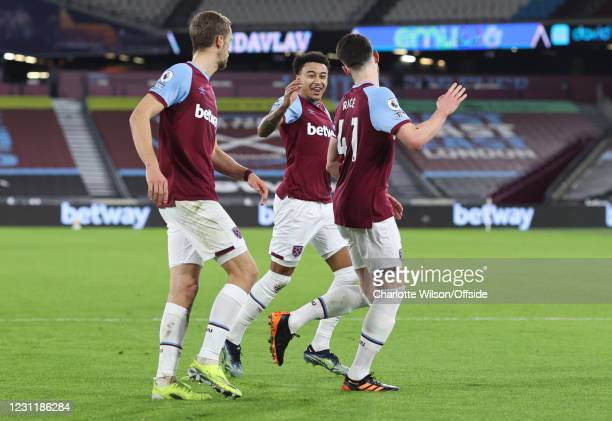 Jesse Lingard of West Ham United celebrates with goalscorer Declan Rice who puts West Ham 1-0 up with a penalty during the Premier League match...