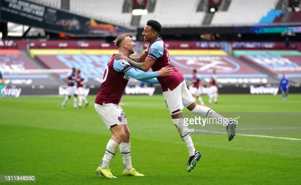 Jesse Lingard of West Ham United celebrates with Jarrod Bowen after scoring their side's second goal during the Premier League match between West Ham...