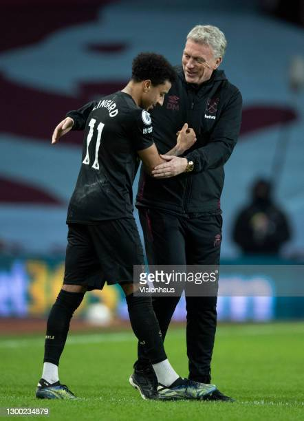 Jesse Lingard of West Ham United celebrates with manager David Moyes after the Premier League match between Aston Villa and West Ham United at Villa...