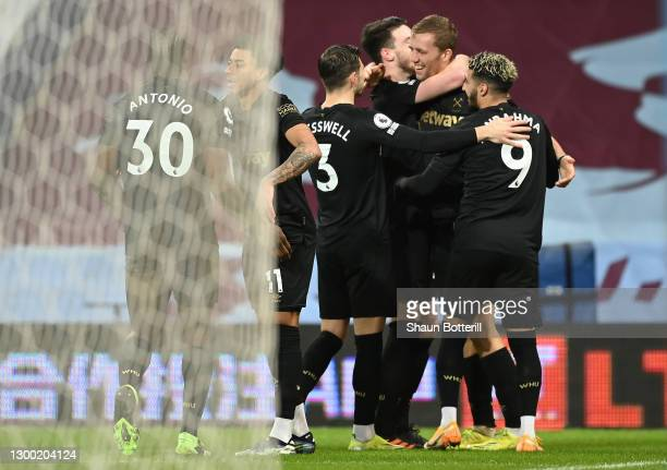 Jesse Lingard of West Ham United celebrates with Michail Antonio, Aaron Cresswell and Said Benrahma after scoring his team's second goal during the...