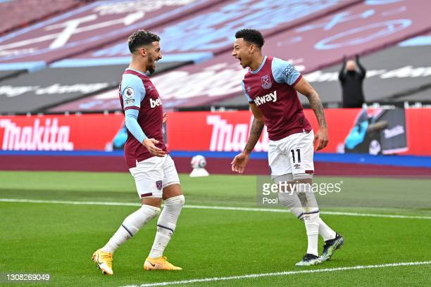 Jesse Lingard of West Ham United celebrates with Said Benrahma after scoring their side's first goal during the Premier League match between West Ham...